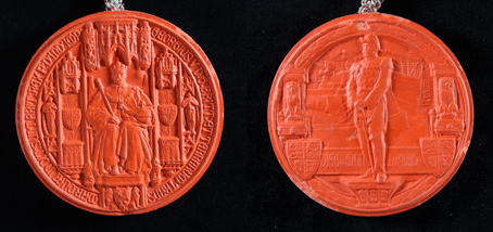 Every monarch has an individual seal - a symbol of status and authority as Head of State. The reverse of George V's first seal (designed by Gilbert Bayes) shows the King on the deck of a battleship.