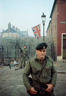 In 1969 two members of the Royal Green Jackets man a street barricade in Belfast during their first tour of duty in Northern Ireland.
