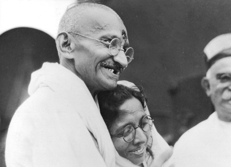 Mohandas Gandhi and fellow activist, Manibehn Patel, on the day of his departure for England in 1931.