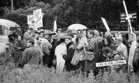 Anti-nuclear protestors stage a demonstration when John F Kennedy visits Britain eight months after the Cuban Missile Crisis.