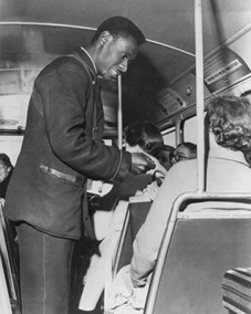 A West Indian bus conductor on a London Transport bus in September 1958.