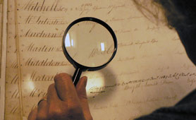 Volunteer with a magnifying glass