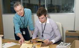 Two people at work at Glamorgan Archives