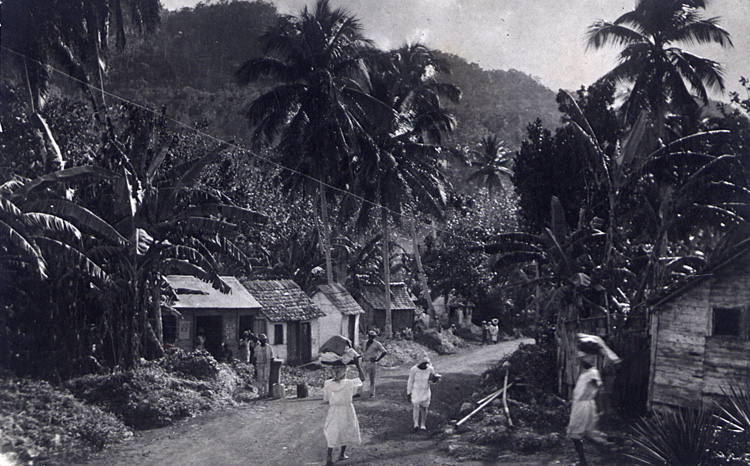 Jamaican village scene with women carrying produce on their heads c1950 (INF 10/153)