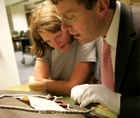An expert examines a document at The National Archives