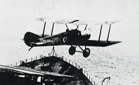 Photograph of biplane over sea (Catalogue reference: AIR 1/720/35/19)