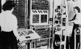 Photograph of two WRNS operating Colossus electronic digital computer, 1943 (Catalogue reference: FO 850/234)