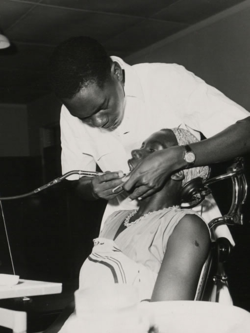 A dental assistant attends a patient at the Dental Unit, Princess Margaret Hospital, Dar es Salaam (1960) - Catalogue reference: CO 1060/164