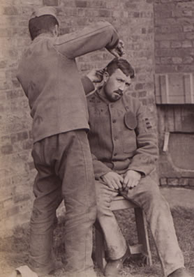 A prisoner receives a haircut (COPY 1/420)