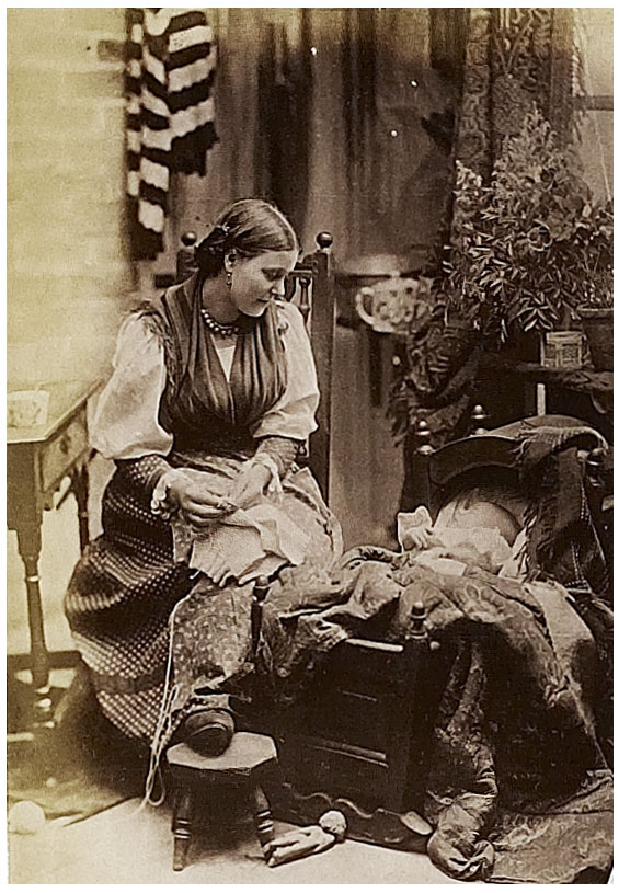 Photograph entitled 'Mother's Pride'; woman with child in a cradle, 1888 (COPY 1/391 f.184)