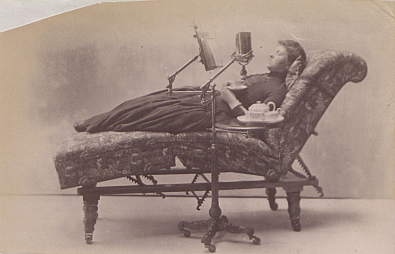 Photograph - Woman reading on a sofa illustrating the use of 'John Carter's Literary Machine with lamp, table and adjustable couch', 1888 (COPY 1/391 f.209)