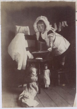 Image of Girl playing with dolls