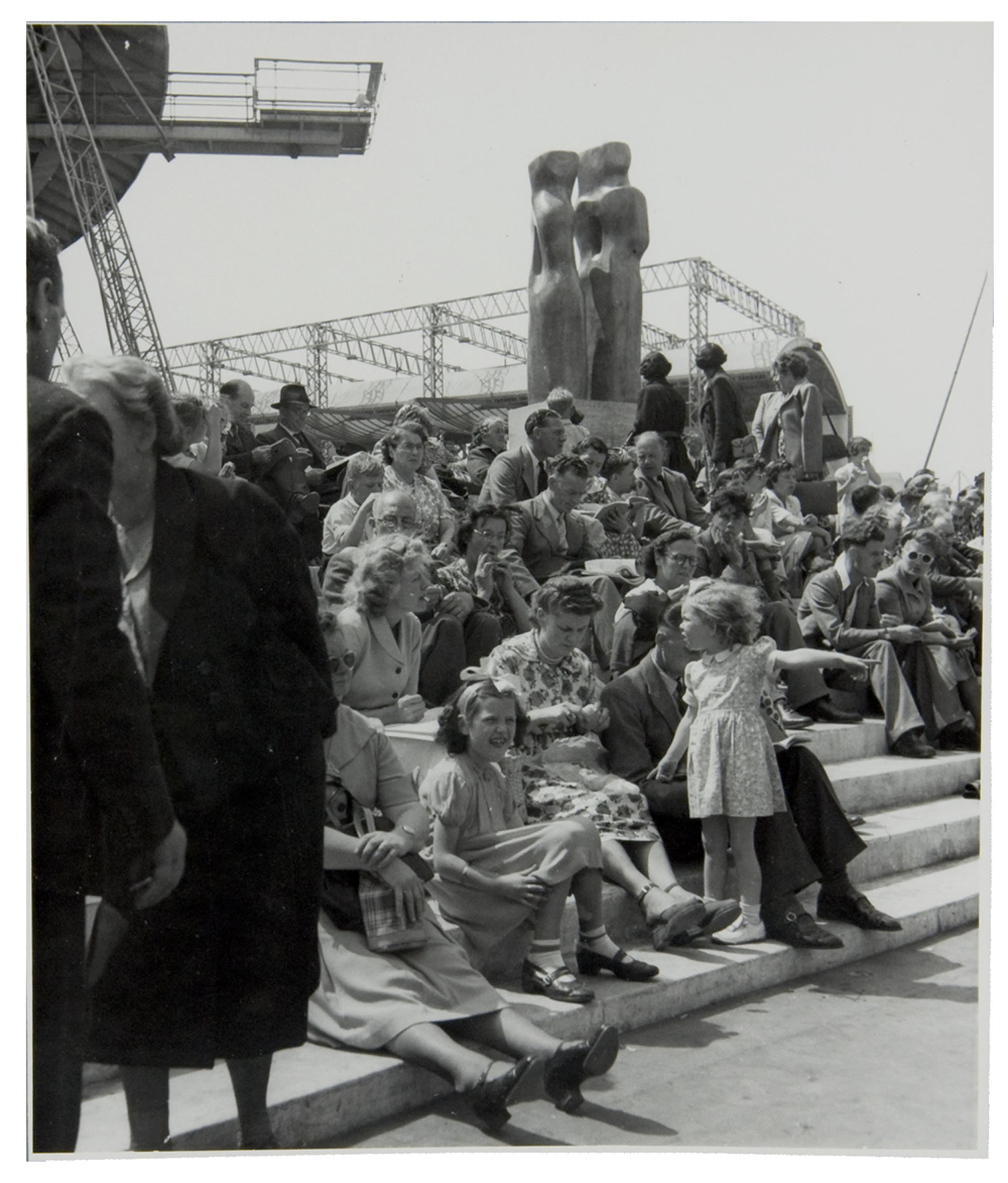 A photograph of a crowd with a Barbara Hepworth sculpture at the Festival of Britain, 1951 (catalogue reference: WORK25/213)