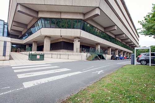 View of accessible parking bays and rear entrance ramp at the rear entrance of the National Archives building.