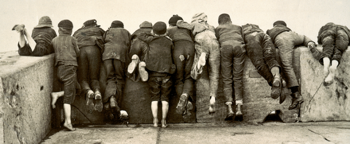 This photograph of twelve boys leaning over a wall, seen from behind, entitled 'Stern Reality' by Frank Meadow Sutcliffe, is among the tens of thousands of photographs registered for copyright and now held at The National Archives. The photograph was registered in 1892 (catalogue reference COPY 1/408/127.