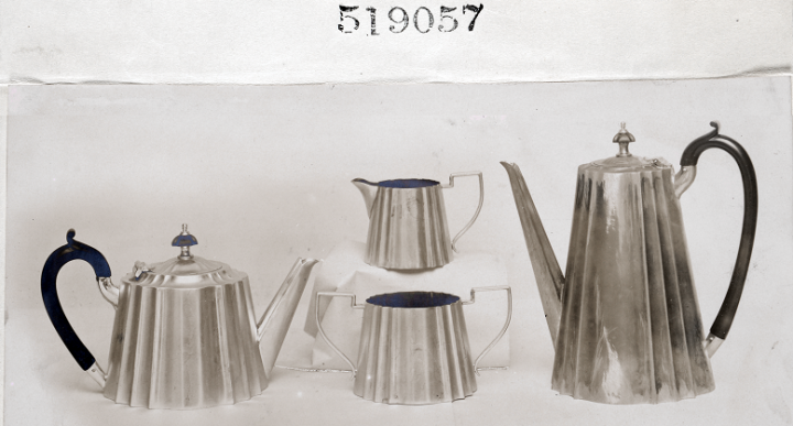 A silver-coloured metallic tea set consisting of a sugar bowl, a jug and two kettles, whose design was registered in 1908 (catalogue reference BT 52/1, registered design number 519057). Representations for non-textile designs came increasingly in the form of photographs.