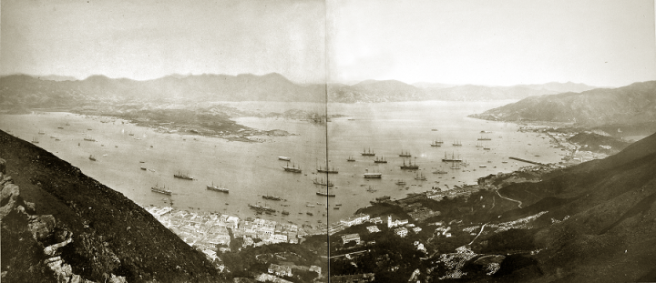 Hilly landscape surrounding a bay in which many boats are anchored. One of several panoramic shots of Hong Kong in the 1890s held in CO 1069 (catalogue reference CO 1069/447).