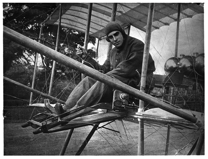 Claude Grahame White, a pioneer of aviation, in 1910 sat in an early aircraft (catalogue reference COPY 1/548/279).