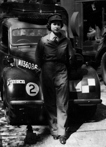 HRH Princess Elizabeth, later Queen Elizabeth II, in her Auxiliary Territorial Service uniform, stood in front of a military car, in 1945 (catalogue reference INF 2/44/612).