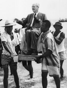Harold Macmillan, carried in the sea at Accra, Ghana, 1960, CO 1069/1/2