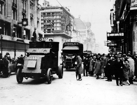 During the General Strike armoured vehicles protect food convoys in London.