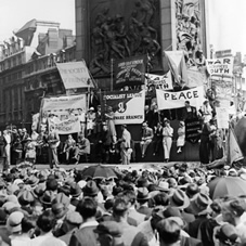 In 1935 a mass demonstration meets in Trafalgar Square to support the League of Nations and the abolition of armaments.