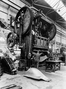 A giant press in operation at the Vauxhall car factory in Luton, Bedfordshire in 1935.