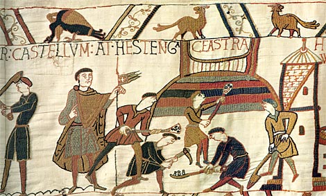 Workmen are depicted building the mound for the castle at Hastings on the Bayeux Tapestry.  By special permission of the City of Bayeux.  Detail of the Bayeux Tapestry, 11th century