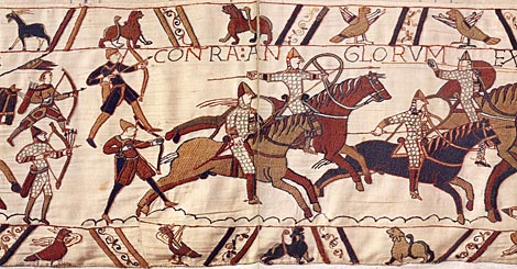 Norman knights supported by archers attack the English at the Battle of Hastings.  By special permission of the City of Bayeux.  Detail of the Bayeux Tapestry, 11th century