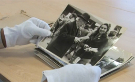 Handling photographs with gloves