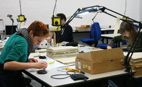 Conservators working on First World War unit war diaries (W0 95)