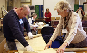 Volunteers cataloguing Miller Maps, reproduced by kind permission of Suffolk Record Office, Ipswich