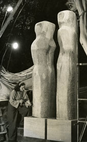 Sculptor Barbara Hepworth working on pieces at her St. Ives studio for the Festival of Britain exhibition, 25 October 1950 (catalogue reference: WORK 25/201)
