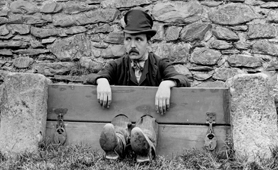 Photograph of a man in the stocks, 1895 (Catalogue reference: COPY 1/420/f801)