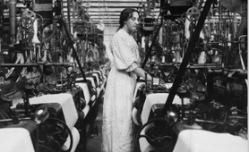 Photograph of woman working in cotton mill, 1907 (Catalogue reference: COPY 1/509)