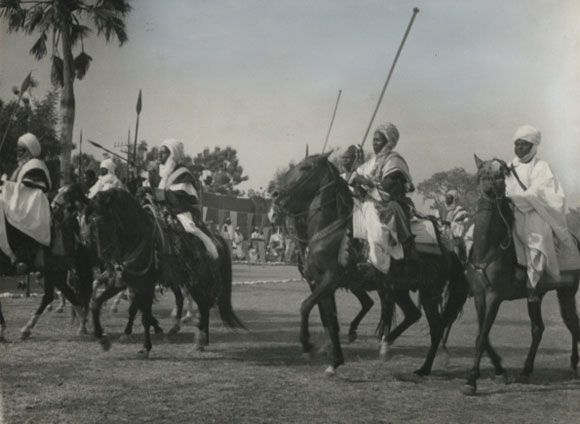 A display of Adamawa Horsemen in honour of Visiting Mission at Yola (1955) - Catalogue reference: CO 1069/24