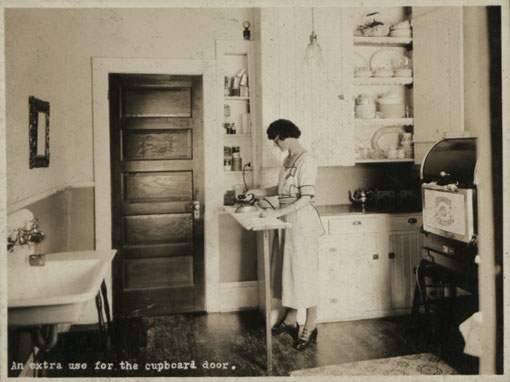 An extra use for the cupboard door: Canada, early 1920s. Catalogue reference: CO 1069/290