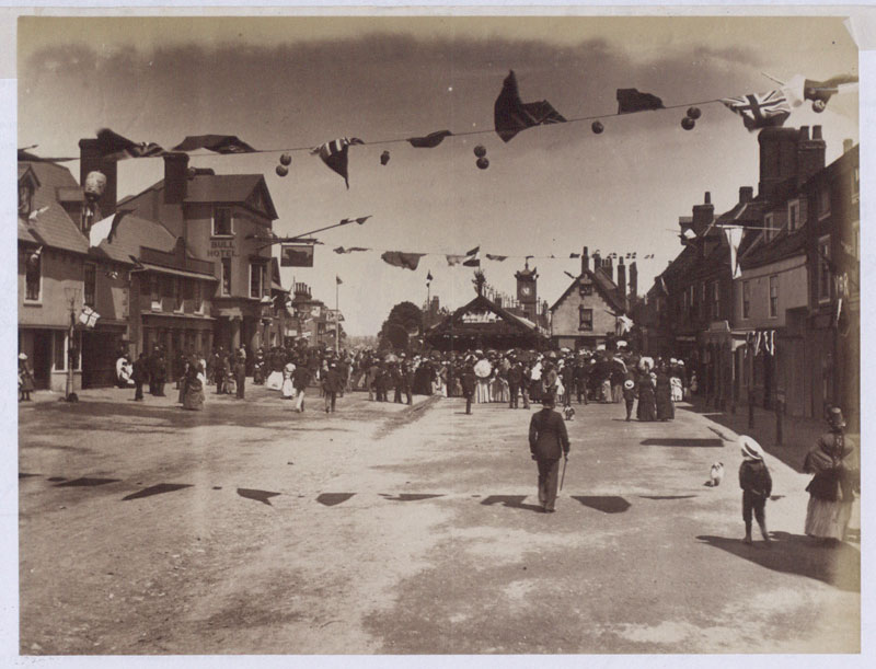 Photograph of High Street Hoddesdon, Hertfordshire, looking north & showing flags across street, Jubilee Day 21 June 1887 (COPY 1/381 f.225)