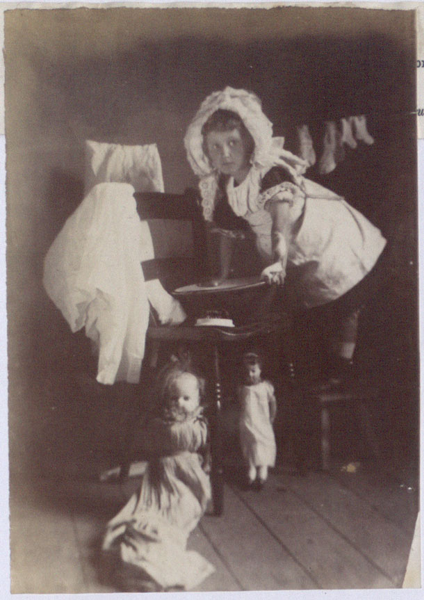"Girl playing with dolls, 1891. There is a caption underneath which reads reads ""Now I am mother"" (COPY 1/405 f.282)"