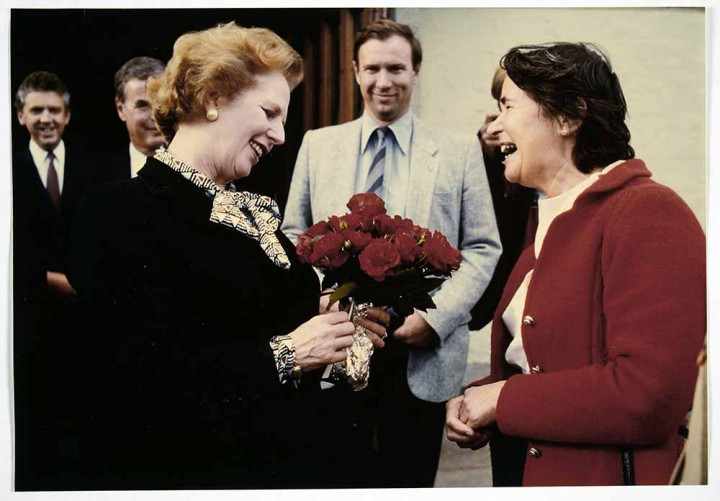 A photograph of Margaret Thatcher being presented with a bunch of flowers