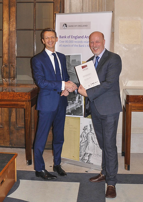 Jeff James presents the Accreditation award to the Bank of England Archive