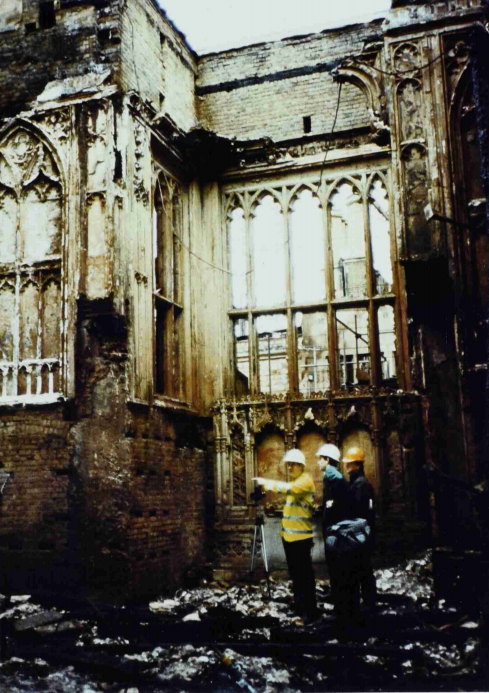 A photograph of workers planning the reconstruction of Windsor Castle after the fire in November 1992 (catalogue reference: PREM 19/4170)
