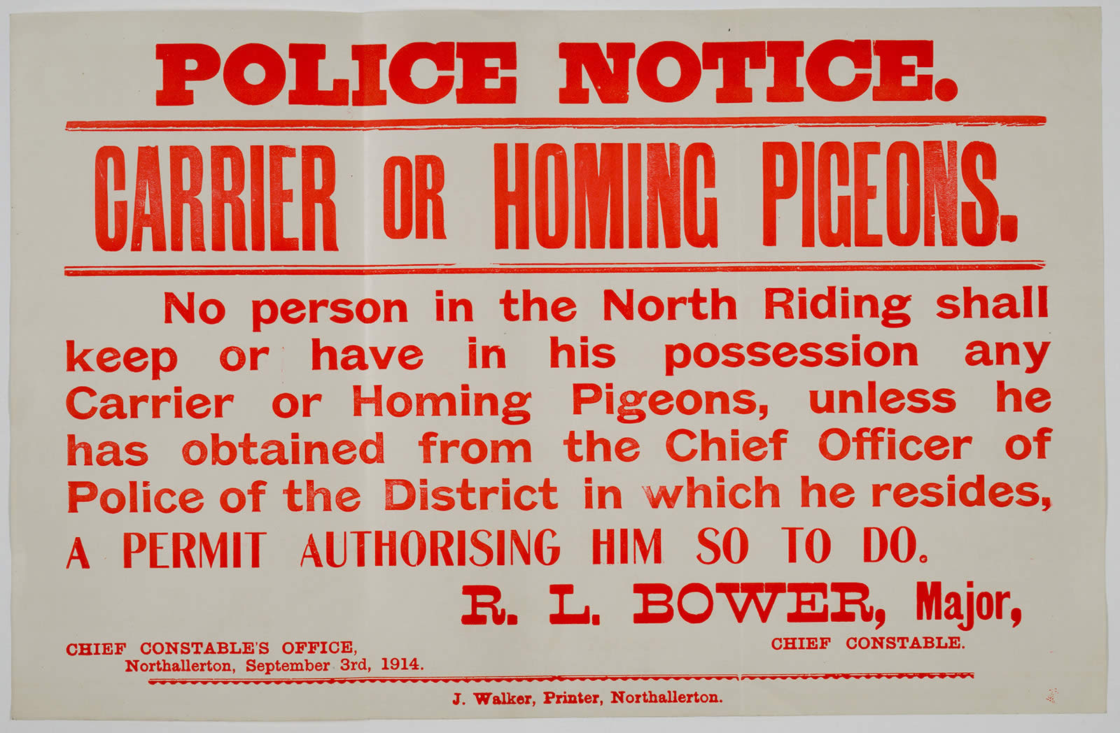 Image of a police notice of 1914 warning owners of homing pigeons that they need a permit
