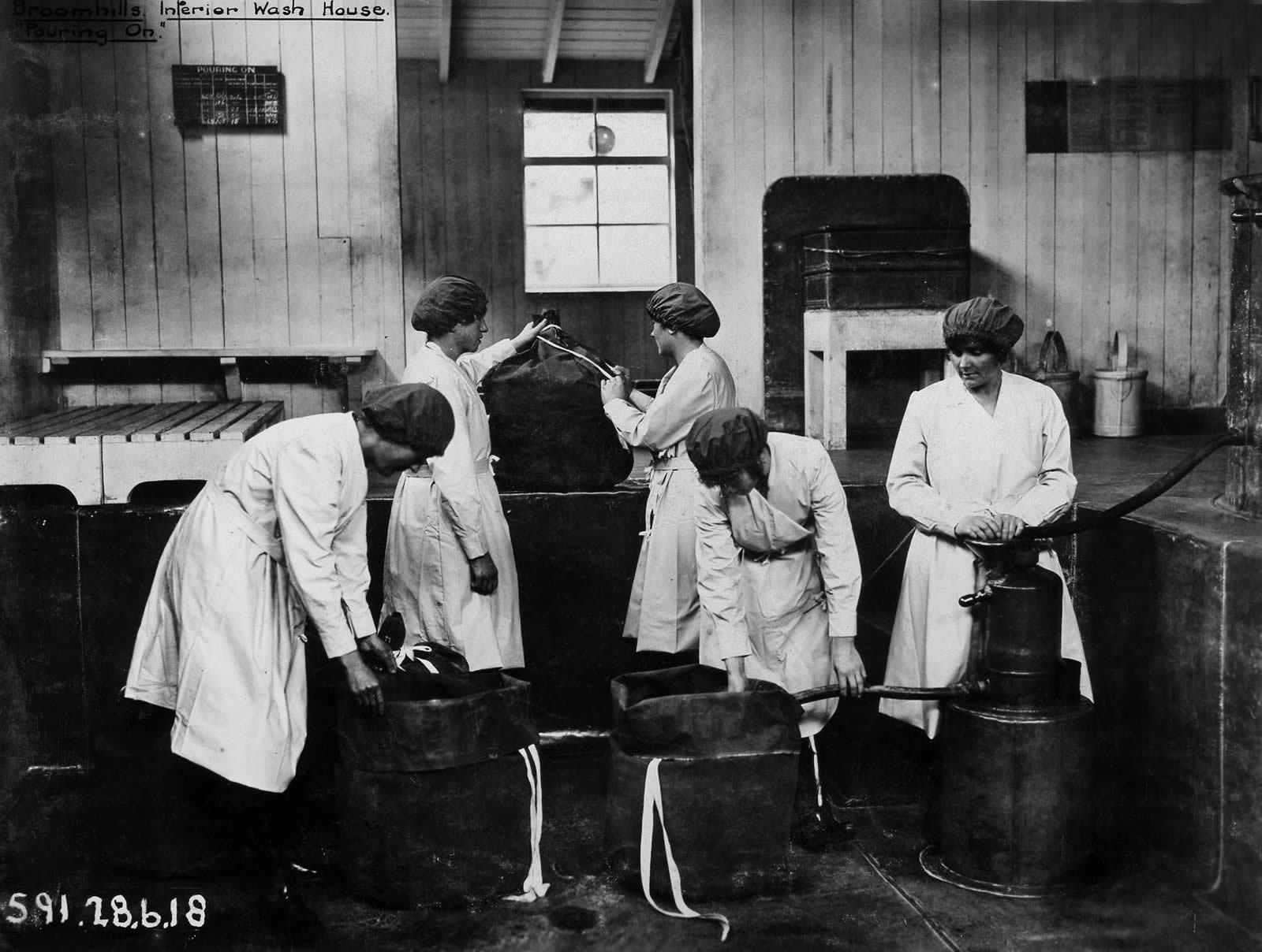 Image of five women working in a wash house